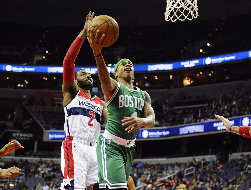 Jan 25, 2016; Washington, DC, USA; Boston Celtics guard Isaiah Thomas (4) shoots as Washington Wizards guard John Wall (2) looks on during the second half at Verizon Center. Boston Celtics won 116 - 91. Mandatory Credit: Brad Mills-USA TODAY Sports