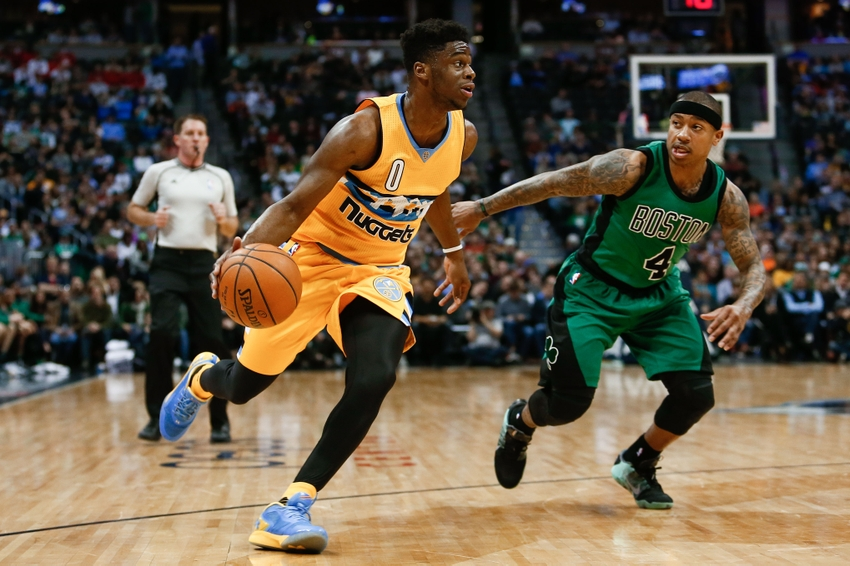 Feb 21, 2016; Denver, CO, USA; Denver Nuggets guard Emmanuel Mudiay (0) dribbles the ball against Boston Celtics guard Isaiah Thomas (4) in the third quarter at the Pepsi Center. The Celtics defeated the Nuggets 121-101. Mandatory Credit: Isaiah J. Downing-USA TODAY Sports