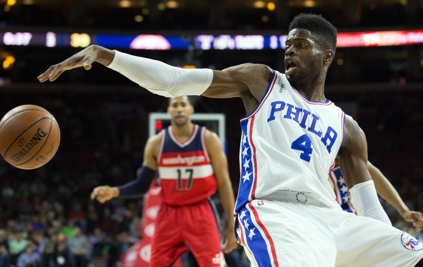 Mar 17, 2016; Philadelphia, PA, USA; Philadelphia 76ers forward Nerlens Noel (4) reaches for a ball and keeps it in bounds against the Washington Wizards during the second quarter at Wells Fargo Center. Mandatory Credit: Bill Streicher-USA TODAY Sports