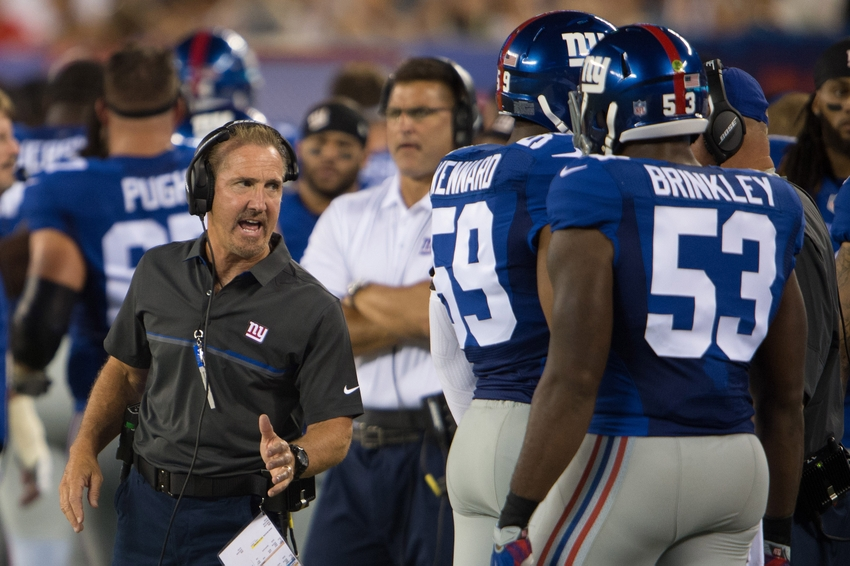 Aug 12, 2016; East Rutherford, NJ, USA; New York Giants defensive coordinator Steve Spagnuolo takes with New York Giants middle linebacker Jasper Brinkley (53) in the first half at MetLife Stadium. Mandatory Credit: William Hauser-USA TODAY Sports