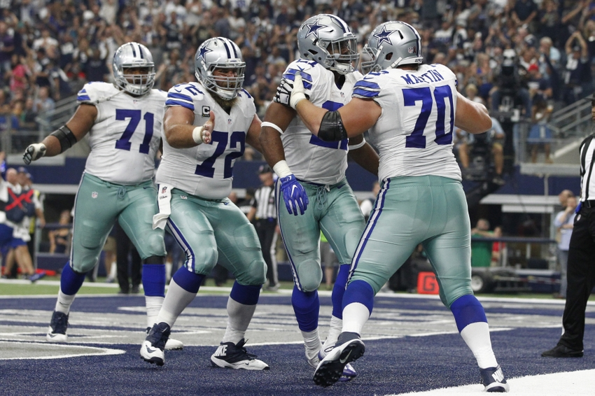 Sep 11, 2016; Arlington, TX, USA; Dallas Cowboys guard Zack Martin (70) and center Travis Frederick (72) celebrate with running back Ezekiel Elliott (21) after he scored a touchdown in the third quarter at AT&T Stadium. Mandatory Credit: Tim Heitman-USA TODAY Sports