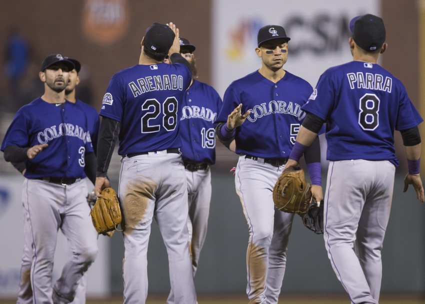 Sep 28, 2016; San Francisco, CA, USA; Colorado Rockies third baseman Nolan Arenado (28) and right fielder Hunter Pence (8) and shortstop Daniel Descalso (3) and center fielder Charlie Blackmon (19) and right fielder Carlos Gonzalez (5) celebrate after the end of the game against the San Francisco Giants at AT&T Park the Colorado Rockies defeated the San Francisco Giants 2 to 0. Mandatory Credit: Neville E. Guard-USA TODAY Sports