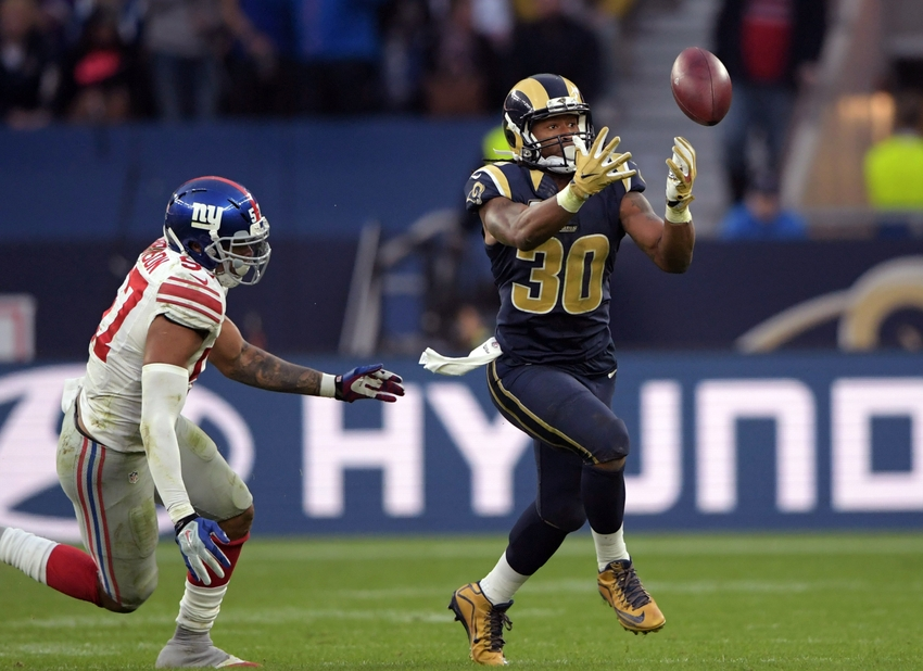 Oct 23, 2016; London, United Kingdom; Los Angeles Rams running back Todd Gurley (30) catches a pass as New York Giants linebacker Keenan Robinson (57) defends during game 16 of the NFL International Series at Twickenham Statdium. The Giants defeated the Rams 17-10. Mandatory Credit: Kirby Lee-USA TODAY Sports