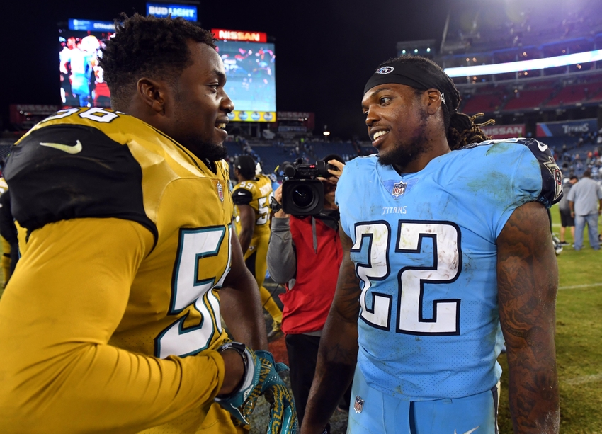 Oct 27, 2016; Nashville, TN, USA; Jacksonville Jaguars defensive end Dante Fowler Jr. (56) talks with Tennessee Titans running back Derrick Henry (22) after the game at Nissan Stadium. The Titans won 36-22. Mandatory Credit: Christopher Hanewinckel-USA TODAY Sports