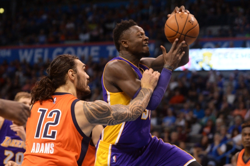Oct 30, 2016; Oklahoma City, OK, USA; Oklahoma City Thunder center Steven Adams (12) fouls Los Angeles Lakers forward Julius Randle (30) during the second quarter at Chesapeake Energy Arena. Mandatory Credit: Mark D. Smith-USA TODAY Sports