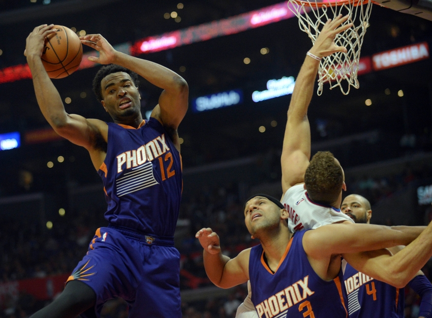 October 31, 2016; Los Angeles, CA, USA; Phoenix Suns forward T.J. Warren (12) grabs a rebound against the Los Angeles Clippers during the first half at Staples Center. Mandatory Credit: Gary A. Vasquez-USA TODAY Sports