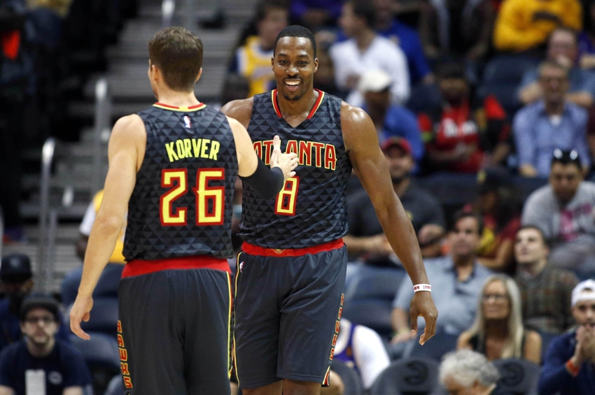 Nov 2, 2016; Atlanta, GA, USA; Atlanta Hawks center Dwight Howard (8) reacts to a play with guard Kyle Korver (26) in the first quarter of their game against the Los Angeles Lakers at Philips Arena. Mandatory Credit: Jason Getz-USA TODAY Sports