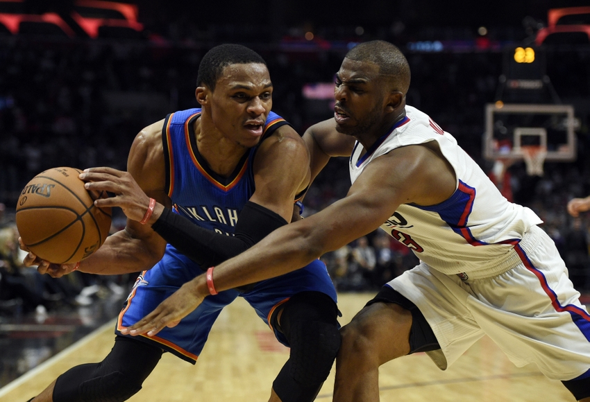 Nov 2, 2016; Los Angeles, CA, USA; Los Angeles Clippers guard Chris Paul (right) attempts to foul Oklahoma City Thunder guard Russell Westbrook (left) during the fourth quarter at Staples Center. The Oklahoma City Thunder won 85-83. Mandatory Credit: Kelvin Kuo-USA TODAY Sports