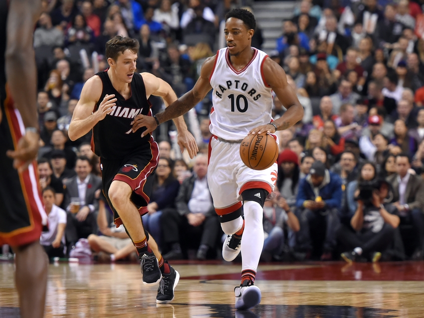 Nov 4, 2016; Toronto, Ontario, CAN; Toronto Raptors guard DeMar DeRozan (10) dribbles the ball up court as he fends off Miami Heat guard Goran Dragic (7) in the second half at Air Canada Centre. Mandatory Credit: Dan Hamilton-USA TODAY Sports