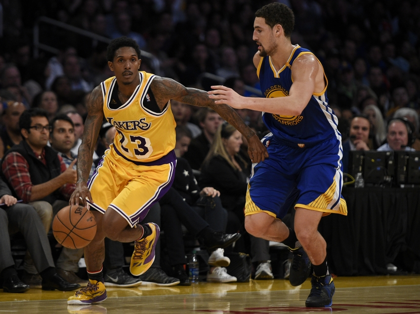 Nov 4, 2016; Los Angeles, CA, USA; Los Angeles Lakers guard Lou Williams (23) drives the ball defended by Golden State Warriors guard Klay Thompson (11) during the fourth quarter at Staples Center. The Los Angeles Lakers won 117-97. Mandatory Credit: Kelvin Kuo-USA TODAY Sports