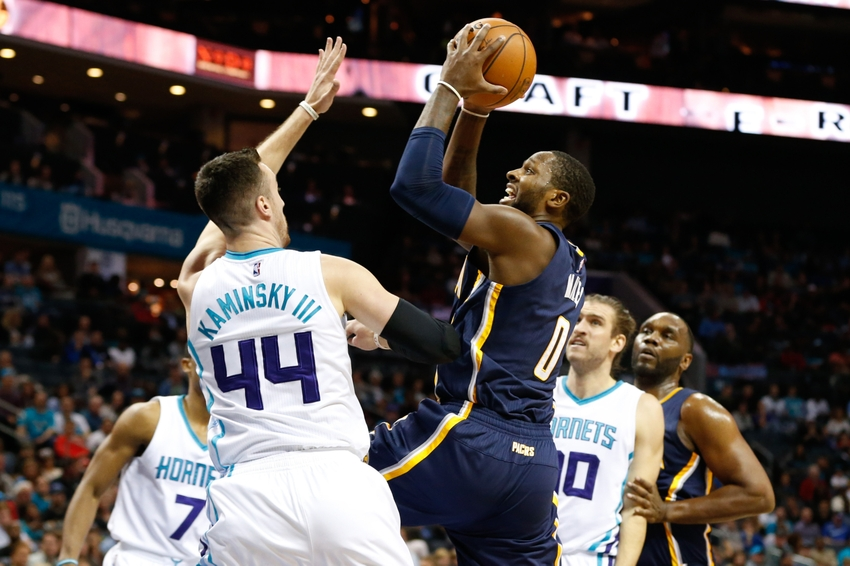 Nov 7, 2016; Charlotte, NC, USA; Indiana Pacers forward C.J. Miles (0) goes up for a shot against Charlotte Hornets center Frank Kaminsky (44) in the first half at Spectrum Center. Mandatory Credit: Jeremy Brevard-USA TODAY Sports