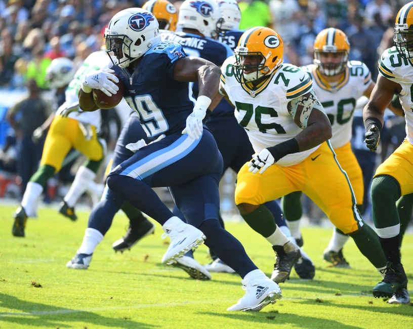 Nov 13, 2016; Nashville, TN, USA; Tennessee Titans running back DeMarco Murray (29) breaks through the line and scores a touchdown during the first half against the Green Bay Packers at Nissan Stadium. Mandatory Credit: Christopher Hanewinckel-USA TODAY Sports