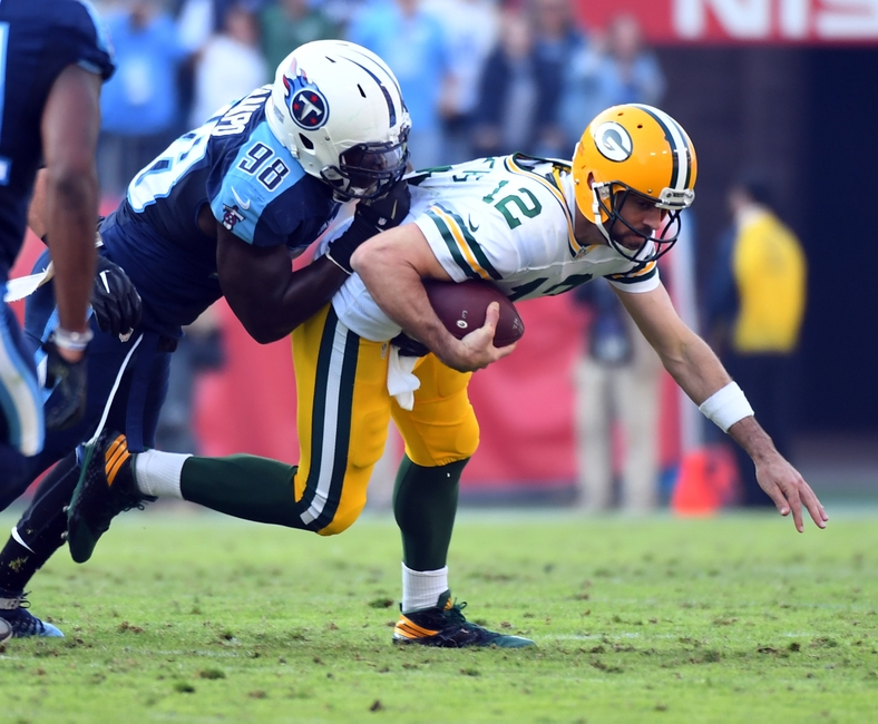Nov 13, 2016; Nashville, TN, USA; Green Bay Packers quarterback Aaron Rodgers (12) is sacked by Tennessee Titans linebacker Brian Orakpo (98) during the second half at Nissan Stadium. The Titans won 47-25. Mandatory Credit: Christopher Hanewinckel-USA TODAY Sports