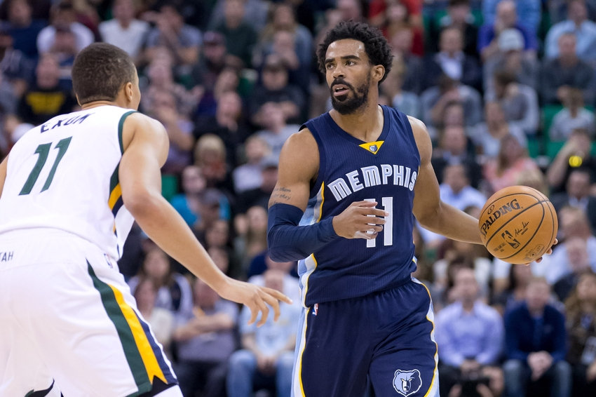 Nov 14, 2016; Salt Lake City, UT, USA; Memphis Grizzlies guard Mike Conley (11) dribbles up the court as Utah Jazz guard Dante Exum (11) defends during the first half at Vivint Smart Home Arena. Mandatory Credit: Russ Isabella-USA TODAY Sports