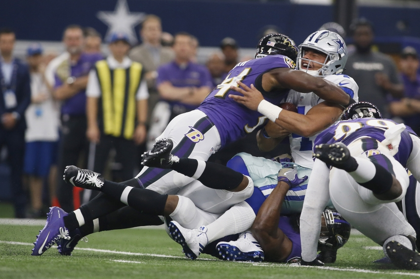 Nov 20, 2016; Arlington, TX, USA; Dallas Cowboys quarterback Dak Prescott (4) is tackled by Baltimore Ravens inside linebacker Zach Orr (54) in the first quarter at AT&T Stadium. Mandatory Credit: Tim Heitman-USA TODAY Sports