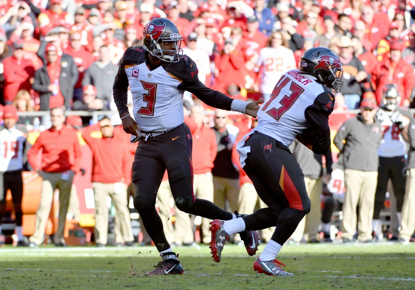 Nov 20, 2016; Kansas City, MO, USA; Tampa Bay Buccaneers quarterback Jameis Winston (3) hands off to running back Peyton Barber (43) during the second half against the Kansas City Chiefs at Arrowhead Stadium. Tampa Bay won 19-17. Mandatory Credit: Denny Medley-USA TODAY Sports