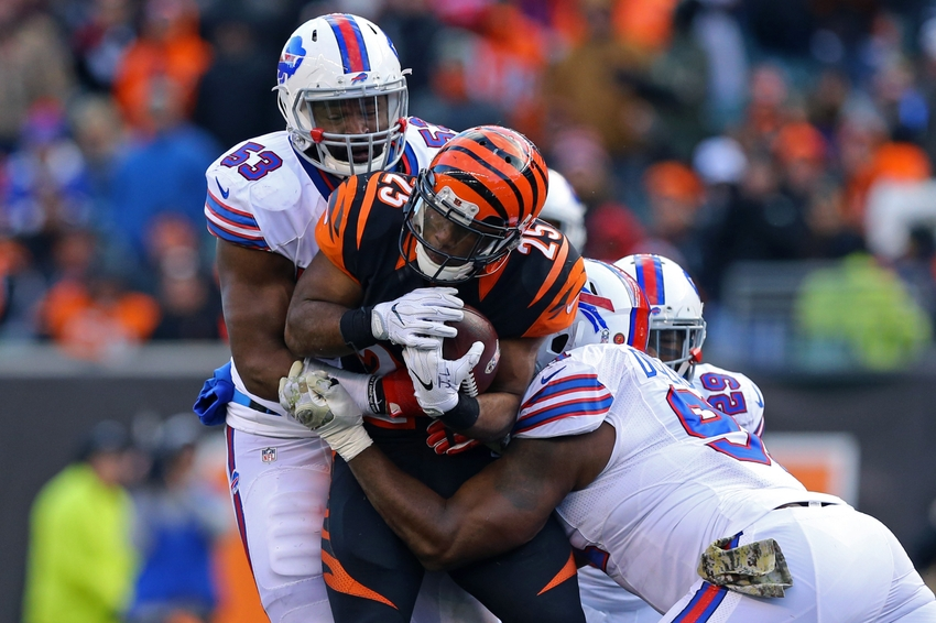 Nov 20, 2016; Cincinnati, OH, USA; Cincinnati Bengals running back Giovani Bernard (25) is tackled by Buffalo Bills inside linebacker Zach Brown (53) and defensive end Leger Douzable (bottom) in the second half at Paul Brown Stadium. The Bills won 16-12. Mandatory Credit: Aaron Doster-USA TODAY Sports