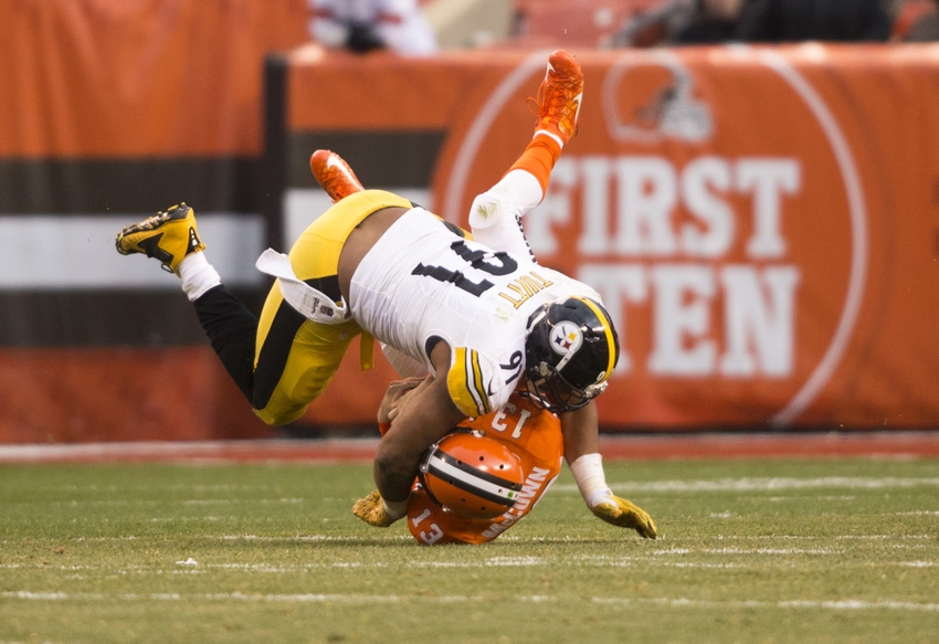Nov 20, 2016; Cleveland, OH, USA; Cleveland Browns quarterback Josh McCown (13) is tackled by Pittsburgh Steelers defensive end Stephon Tuitt (91) during the fourth quarter at FirstEnergy Stadium. The Steelers won 24-9. Mandatory Credit: Scott R. Galvin-USA TODAY Sports