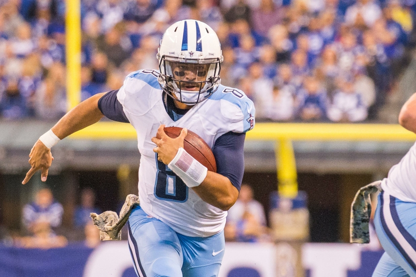 Nov 20, 2016; Indianapolis, IN, USA; Tennessee Titans quarterback Marcus Mariota (8) runs the ball in the second half of the game against the Indianapolis Colts at Lucas Oil Stadium. Indianapolis Colts beat the Tennessee Titans 24-17. Mandatory Credit: Trevor Ruszkowski-USA TODAY Sports