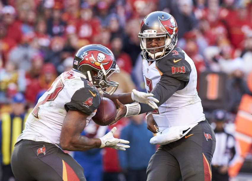 Nov 20, 2016; Kansas City, MO, USA; Tampa Bay Buccaneers quarterback Jameis Winston (3) hands the ball off to running back Doug Martin (22) against the Kansas City Chiefs at Arrowhead Stadium. Mandatory Credit: Gary Rohman-USA TODAY Sports