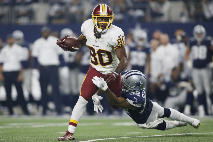 Nov 24, 2016; Arlington, TX, USA; Washington Redskins wide receiver Jamison Crowder (80) avoids the tackle of Dallas Cowboys cornerback Orlando Scandrick (32) in the fourth quarter at AT&T Stadium. Dallas won 31-26. Mandatory Credit: Tim Heitman-USA TODAY Sports