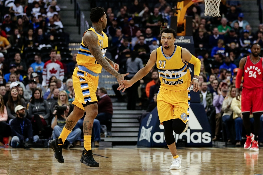 Nov 18, 2016; Denver, CO, USA; Denver Nuggets forward Wilson Chandler (21) and guard Jamal Murray (27) react after a play in the third quarter against the Toronto Raptors at the Pepsi Center. The Raptors won 113-111 in overtime. Mandatory Credit: Isaiah J. Downing-USA TODAY Sports
