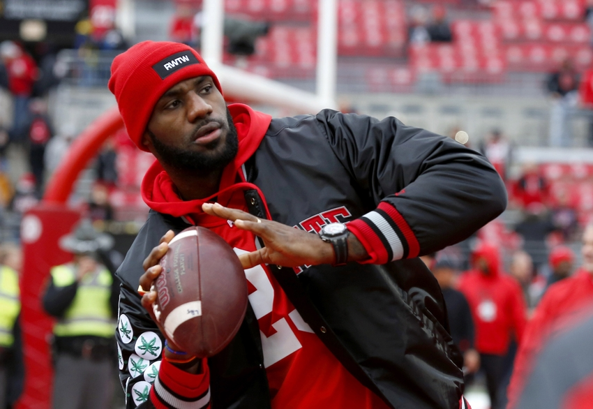 Nov 26, 2016; Columbus, OH, USA; Cleveland Cavaliers player LeBron James plays catch with the Ohio State Buckeyes team before the game against the Michigan Wolverines at Ohio Stadium. Mandatory Credit: Joe Maiorana-USA TODAY Sports