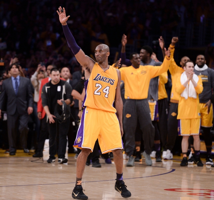 Apr 13, 2016; Los Angeles, CA, USA; Los Angeles Lakers forward Kobe Bryant (24) waves to the crowd as he heads to the bench before the end of the Lakers win over the Utah Jazz at Staples Center. Bryant scored 60 points in the final game of his career. Mandatory Credit: Robert Hanashiro-USA TODAY Sports