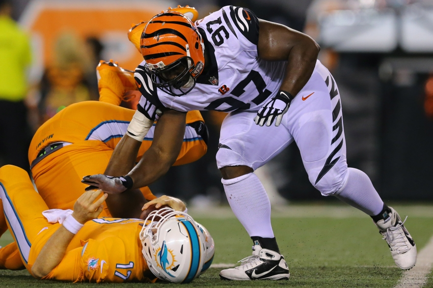 Sep 29, 2016; Cincinnati, OH, USA; Cincinnati Bengals defensive tackle Geno Atkins (97) sacks Miami Dolphins quarterback Ryan Tannehill (17) in the second half at Paul Brown Stadium. The Bengals won 22-7. Mandatory Credit: Aaron Doster-USA TODAY Sports