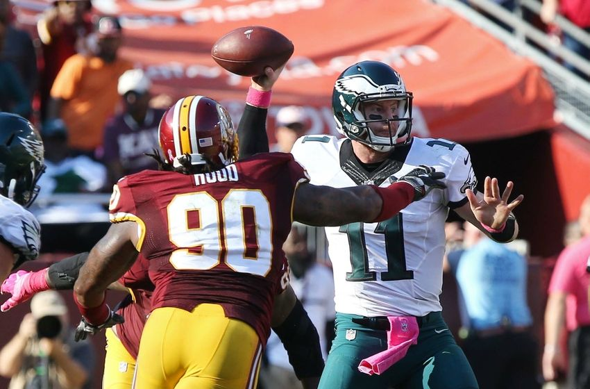 Oct 16, 2016; Landover, MD, USA; Philadelphia Eagles quarterback Carson Wentz (11) throws the ball as Washington Redskins defensive end Ziggy Hood (90) chases in the fourth quarter at FedEx Field. The Redskins won 27-20. Mandatory Credit: Geoff Burke-USA TODAY Sports