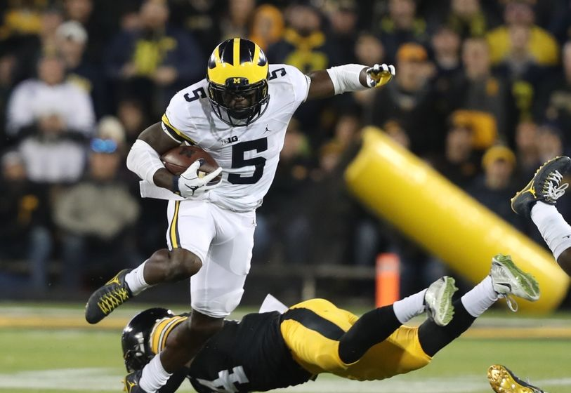 Nov 12, 2016; Iowa City, IA, USA; Michigan Wolverines linebacker Jabrill Peppers (5) carries the ball as Iowa Hawkeyes defensive back Desmond King (14) defends during the first half at Kinnick Stadium. Mandatory Credit: Reese Strickland-USA TODAY Sports