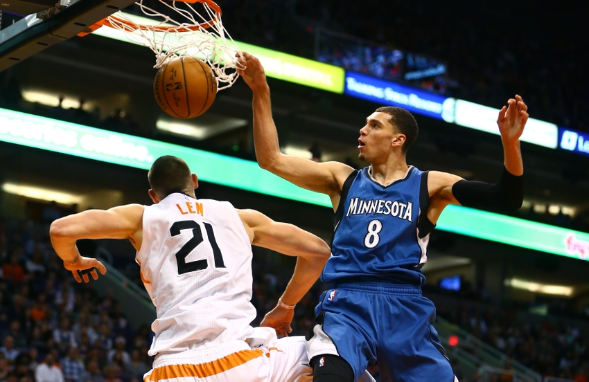 Nov 25, 2016; Phoenix, AZ, USA; Minnesota Timberwolves guard Zach LaVine (right) goes up for a dunk over Phoenix Suns center Alex Len in the first quarter at Talking Stick Resort Arena. Mandatory Credit: Mark J. Rebilas-USA TODAY Sports