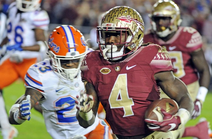 Nov 26, 2016; Tallahassee, FL, USA; Florida State Seminoles running back Dalvin Cook (4) runs the ball for a touchdown past Florida Gators defensive back Chauncey Gardner Jr. (23) during the first quarter at Doak Campbell Stadium. Mandatory Credit: Melina Vastola-USA TODAY Sports