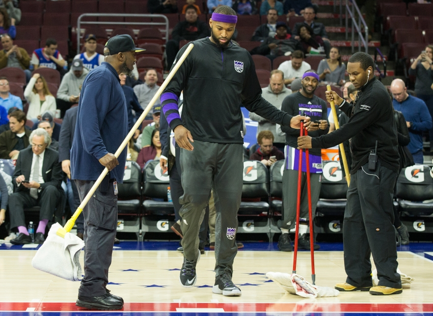 Sacramento Kings center DeMarcus Cousins (middle) was looking for any way to contribute in yesterday's FanDuel daily picks. Mandatory Credit: Bill Streicher-USA TODAY Sports