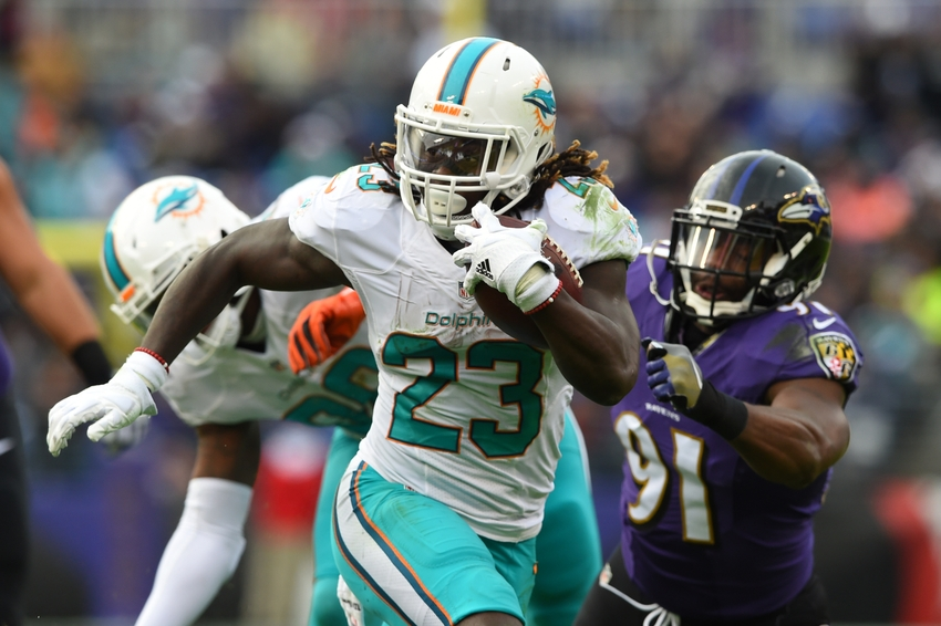 Dec 4, 2016; Baltimore, MD, USA; Miami Dolphins running back Jay Ajayi (23) runs past Baltimore Ravens linebacker Matt Judon (91) during the second half at M&T Bank Stadium. Baltimore Ravens defeated Miami Dolphins 38-6. Mandatory Credit: Tommy Gilligan-USA TODAY Sports