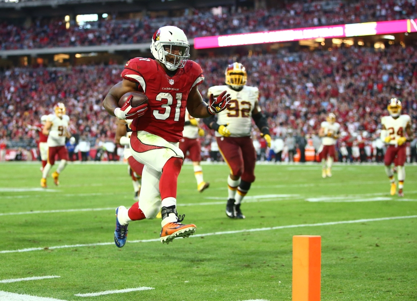 Dec 4, 2016; Glendale, AZ, USA; Arizona Cardinals running back David Johnson (31) runs for a fourth quarter touchdown against the Washington Redskins at University of Phoenix Stadium. The Cardinals defeated the Redskins 31-23. Mandatory Credit: Mark J. Rebilas-USA TODAY Sports