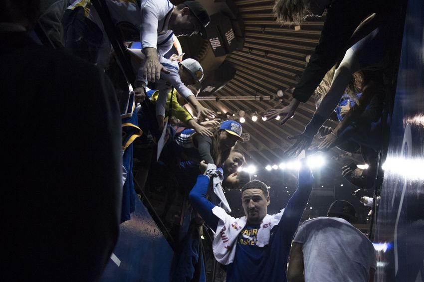December 5, 2016; Oakland, CA, USA; Golden State Warriors guard Klay Thompson (11) high-fives fans leaving the court after the game against the Indiana Pacers at Oracle Arena. The Warriors defeated the Pacers 142-106. Mandatory Credit: Kyle Terada-USA TODAY Sports