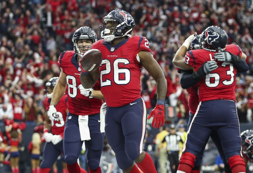 Dec 18, 2016; Houston, TX, USA; Houston Texans running back Lamar Miller (26) celebrates after scoring a touchdown during the fourth quarter against the Jacksonville Jaguars at NRG Stadium. Mandatory Credit: Troy Taormina-USA TODAY Sports