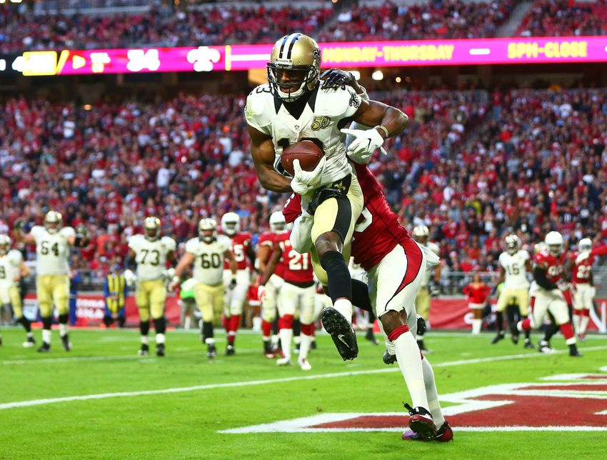 Dec 18, 2016; Glendale, AZ, USA; New Orleans Saints wide receiver Michael Thomas (13) catches a touchdown against Arizona Cardinals cornerback Brandon Williams (13) in the fourth quarter at University of Phoenix Stadium. The Saints defeated the Cardinals 48-41. Mandatory Credit: Mark J. Rebilas-USA TODAY Sports
