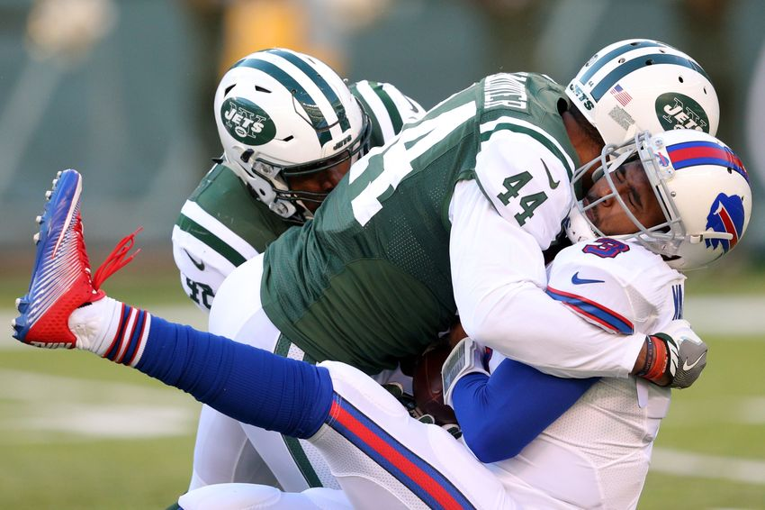 Jan 1, 2017; East Rutherford, NJ, USA; Buffalo Bills quarterback EJ Manuel (3) fumbles the ball after being sacked by New York Jets linebacker Corey Lemonier (44) and New York Jets linebacker Jordan Jenkins (48) during the third quarter at MetLife Stadium. Mandatory Credit: Brad Penner-USA TODAY Sports