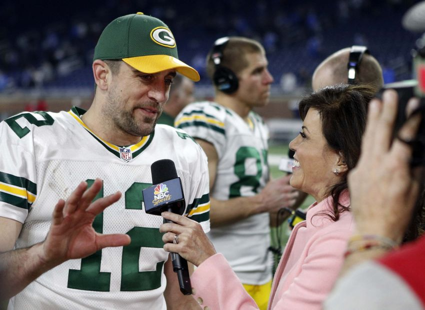 Jan 1, 2017; Detroit, MI, USA; Green Bay Packers quarterback Aaron Rodgers (12) does an interview with Michele Tafoya after the game against the Detroit Lions at Ford Field. Packers won 31-24. Mandatory Credit: Raj Mehta-USA TODAY Sports