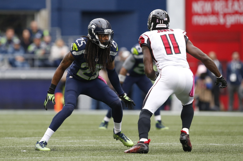 Oct 16, 2016; Seattle, WA, USA; Seattle Seahawks cornerback Richard Sherman (25) defends Atlanta Falcons wide receiver Julio Jones (11) during the second quarter at CenturyLink Field. Mandatory Credit: Joe Nicholson-USA TODAY Sports