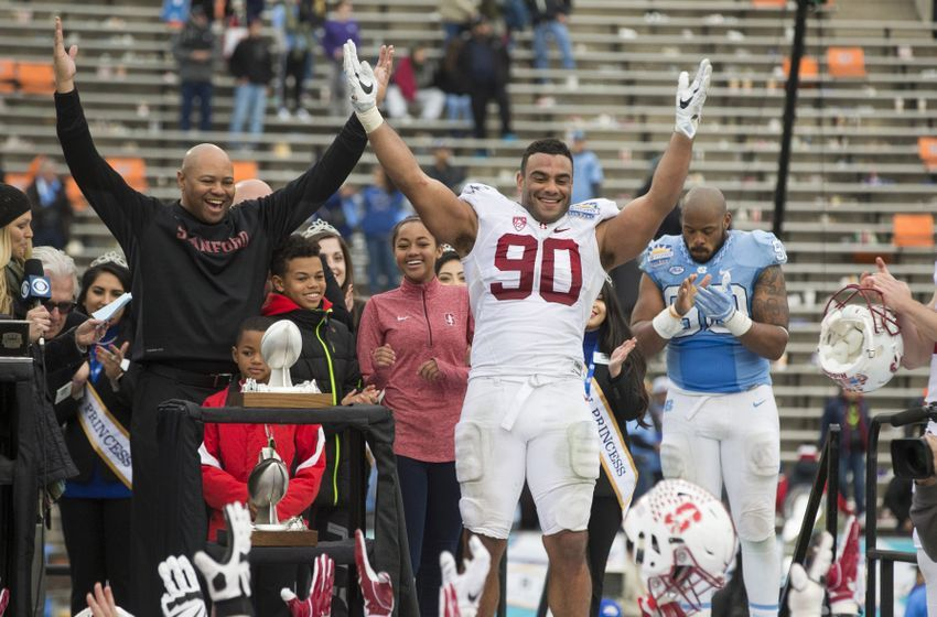 Dec 30, 2016; El Paso, TX, USA; Stanford Cardinal defensive lineman Solomon Thomas (90) celebrates with head coach David Shaw (L) after defeating the North Carolina Tar Heels 25-23 at Sun Bowl Stadium. Thomas was named MVP of the game. Mandatory Credit: Ivan Pierre Aguirre-USA TODAY Sports