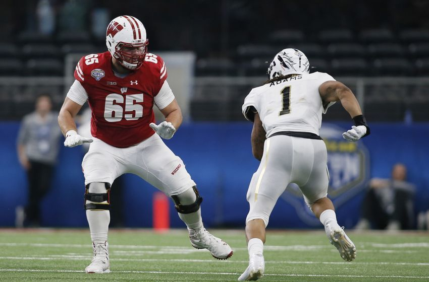 Jan 2, 2017; Arlington, TX, USA; Wisconsin Badgers offensive lineman Ryan Ramczyk (65) blocks Western Michigan Broncos defensive end Keion Adams (1) in the third quarter at AT&T Stadium. The Badgers won 24-16. Mandatory Credit: Tim Heitman-USA TODAY Sports