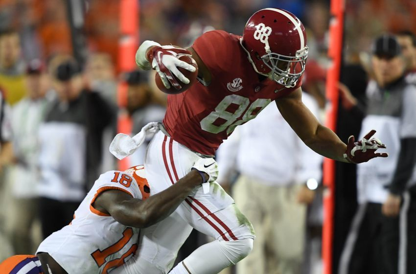 Jan 9, 2017; Tampa, FL, USA; Alabama Crimson Tide tight end O.J. Howard (88) runs the ball while guarded by Clemson Tigers safety Jadar Johnson (18) during the fourth quarter in the 2017 College Football Playoff National Championship Game at Raymond James Stadium. Mandatory Credit: John David Mercer-USA TODAY Sports