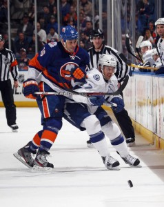 UNIONDALE, NY - DECEMBER 06: Marty Reasoner #16 of the New York Islanders leans on Bruno Gervais #27 of the Tampa Bay Lightning at the Nassau Veterans Memorial Coliseum on December 6, 2011 in Uniondale, New York. The Islanders defeated the Lightning 5-1. (Photo by Bruce Bennett/Getty Images)