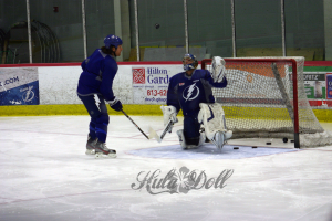 Steve Downie And Dwayne Roloson eye a flying puck at practice. Taken by: Dolly Dolce