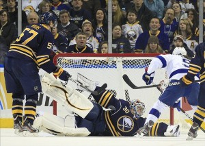 Feb 11, 2012; Buffalo, NY, USA; Tampa Bay Lightning right wing Steve Downie (9) scores on Buffalo Sabres goalie Ryan Miller (30) during the second period at the the First Niagara Center. Mandatory Credit: Kevin Hoffman-US PRESSWIRE