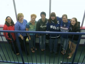 A group of female hockey fans at a Lightning practice