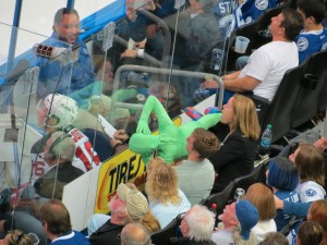 An imitation 'Green Man' messes with a New Jersey Devil in the penalty box. Photo taken by: Dolly Dolce